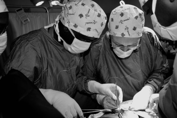 Two doctors preforming surgery
